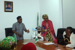 The National Chairman of PDP receiving the Charter of demands from the National Woman Leader of the party.